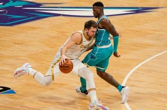 Doncic has 34 points, Mavs beat Hornets in Porzingis' return