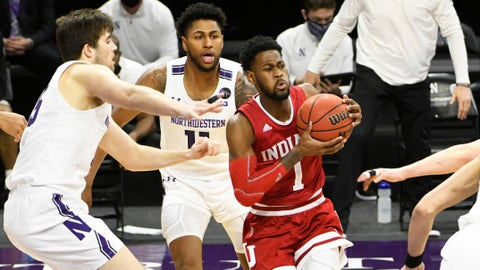 Feb 10, 2021; Evanston, Illinois, USA; Indiana Hoosiers guard Al Durham (1) is defended by Northwestern Wildcats center Ryan Young (15) during the first half at Welsh-Ryan Arena. Mandatory Credit: David Banks-USA TODAY Sports