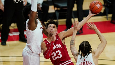 Indiana forward Trayce Jackson-Davis (23) looks to shoot with Rutgers center Myles Johnson, left, and guard Caleb McConnell (22) defending during the first half of an NCAA college basketball game Wednesday, Feb. 24, 2021, in Piscataway, N.J. (AP Photo/Kathy Willens)
