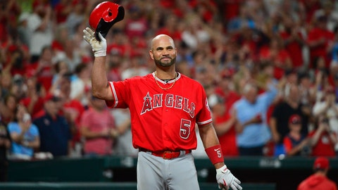 Jun 23, 2019; St. Louis, MO, USA; Los Angeles Angels first baseman Albert Pujols (5) salutes the fans as he receives a standing ovation during the ninth inning against the St. Louis Cardinals at Busch Stadium. Mandatory Credit: Jeff Curry-USA TODAY Sports