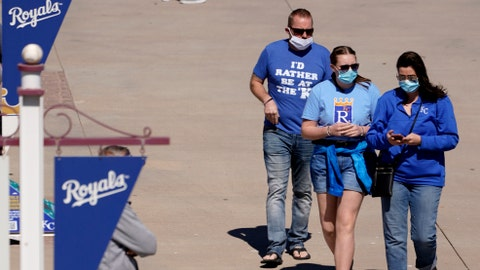 Kansas City Royals fans walk to their seats before a spring training baseball game against the Texas Rangers, Sunday, Feb. 28, 2021, in Surprise, Ariz. (AP Photo/Charlie Riedel)