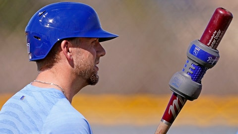 Kansas City Royals' Hunter Dozier gets ready to bat during spring training baseball practice Monday, Feb. 22, 2021, in Surprise, Ariz. (AP Photo/Charlie Riedel)