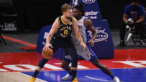 Feb 11, 2021; Detroit, Michigan, USA; Indiana Pacers forward Domantas Sabonis (11) backs down Detroit Pistons center Isaiah Stewart (right) during the first quarter at Little Caesars Arena. Mandatory Credit: Tim Fuller-USA TODAY Sports