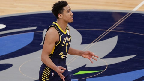 Feb 17, 2021; Minneapolis, Minnesota, USA; Indiana Pacers guard Malcolm Brogdon (7) celebrates his basket in overtime against the Minnesota Timberwolves at Target Center. Mandatory Credit: Brad Rempel-USA TODAY Sports
