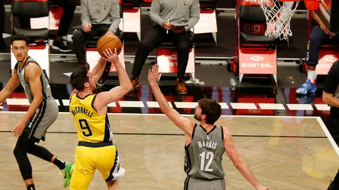 Feb 10, 2021; Brooklyn, New York, USA; Indiana Pacers guard T.J. McConnell (9) shoots against Brooklyn Nets forward Joe Harris (12) during the first half at Barclays Center. Mandatory Credit: Andy Marlin-USA TODAY Sports