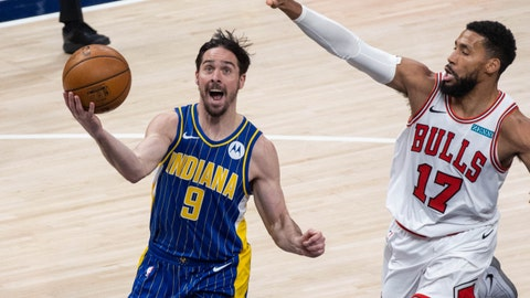 Feb 15, 2021; Indianapolis, Indiana, USA; Indiana Pacers guard T.J. McConnell (9) shoots the ball while Chicago Bulls guard Garrett Temple (17) defends  in the fourth quarter at Bankers Life Fieldhouse. Mandatory Credit: Trevor Ruszkowski-USA TODAY Sports