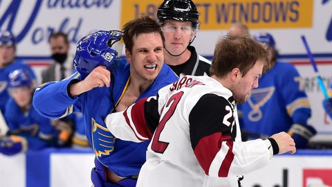 Feb 6, 2021; St. Louis, Missouri, USA;  St. Louis Blues center Brayden Schenn (10) fights Arizona Coyotes left wing Johan Larsson (22) during the second period at Enterprise Center. Mandatory Credit: Jeff Curry-USA TODAY Sports