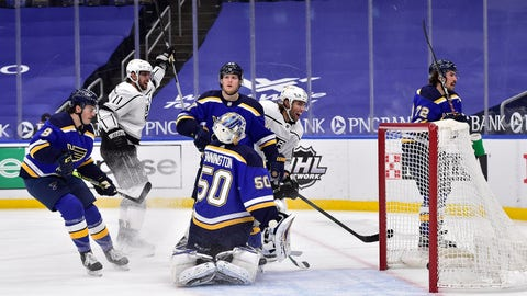 Feb 24, 2021; St. Louis, Missouri, USA;  Los Angeles Kings right wing Alex Iafallo (19) celebrates after scoring against St. Louis Blues goaltender Jordan Binnington (50) during the second period at Enterprise Center. Mandatory Credit: Jeff Curry-USA TODAY Sports