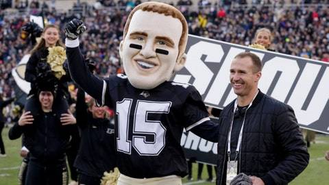 Purdue alumn and NFL quarterback Drew Brees embraces a Drew Brees mascot during the fourth quarter of a NCAA football game, Saturday, Nov. 2, 2019 at Ross-Ade Stadium in West Lafayette.  Cfb Purdue Vs Nebraska