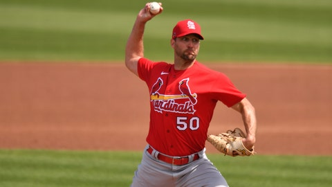Mar 2, 2021; Jupiter, Florida, USA; St. Louis Cardinals starting pitcher Adam Wainwright (50) pitches against the Miami Marlins during a spring training game at Roger Dean Chevrolet Stadium. Mandatory Credit: Jim Rassol-USA TODAY Sports