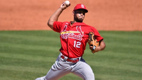 Mar 14, 2021; Port St. Lucie, Florida, USA; St. Louis Cardinals relief pitcher Jordan Hicks (12) pitches against the New York Mets during a spring training game at Clover Park. Mandatory Credit: Jim Rassol-USA TODAY Sports