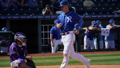 Kansas City Royals' Ryan O'Hearn, right, scores in front of Colorado Rockies catcher Dom Nunez on a Single by Hanser Alberto in the fifth inning of a spring training baseball game Sunday, March 21, 2021, in Surprise, Ariz. (AP Photo/Sue Ogrocki)