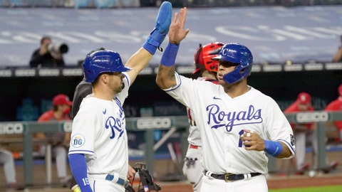 Sep 21, 2020; Kansas City, Missouri, USA; Kansas City Royals catcher Salvador Perez (13) and right fielder Whit Merrifield (15) celebrate after scoring in the sixth inning against the St. Louis Cardinals at Kauffman Stadium. Mandatory Credit: Denny Medley-USA TODAY Sports