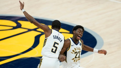 Indiana Pacers' Caris LeVert (22) and Edmond Sumner (5) celebrate during the second half of an NBA basketball game, Wednesday, March 24, 2021, in Indianapolis. The Pacers won 116-111. (AP Photo/Darron Cummings)