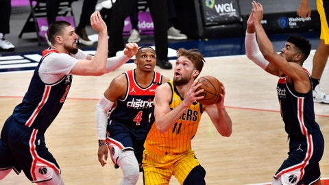 Mar 29, 2021; Washington, District of Columbia, USA; Indiana Pacers forward Domantas Sabonis (11) shoots the ball over Washington Wizards center Alex Len (27) and  during the third quarter at Capital One Arena. Mandatory Credit: Brad Mills-USA TODAY Sports
