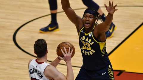 Mar 21, 2021; Miami, Florida, USA; Indiana Pacers center Myles Turner (33) defends Miami Heat guard Duncan Robinson (55) in the third quarter at American Airlines Arena. Mandatory Credit: Jim Rassol-USA TODAY Sports