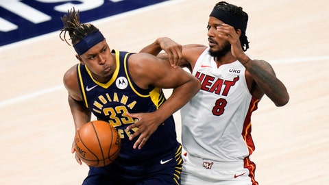 Indiana Pacers center Myles Turner (33) moves in front of Miami Heat forward Trevor Ariza (8) during the first half of an NBA basketball game in Indianapolis, Wednesday, March 31, 2021. (AP Photo/AJ Mast)