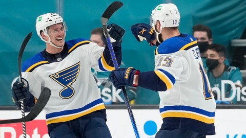 St. Louis Blues center Tyler Bozak, left, celebrates with teammate Kyle Clifford (13) after scoring a goal against the San Jose Sharks during the third period of an NHL hockey game in San Jose, Calif., Friday, March 19, 2021. (AP Photo/Tony Avelar)