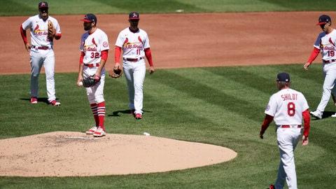 St. Louis Cardinals starting pitcher Daniel Ponce de Leon (32) waits on the mound to be removed by manager Mike Shildt (8) during the second inning of a baseball game against the Milwaukee Brewers Sunday, April 11, 2021, in St. Louis. (AP Photo/Jeff Roberson)
