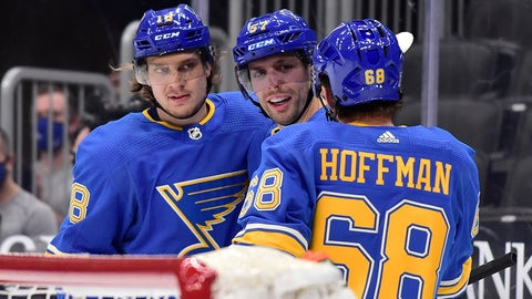 Jan 23, 2021; St. Louis, Missouri, USA;  St. Louis Blues left wing David Perron (57) is congratulated by center Robert Thomas (18) and left wing Mike Hoffman (68) after scoring against the Los Angeles Kings during the second period at Enterprise Center. Mandatory Credit: Jeff Curry-USA TODAY Sports