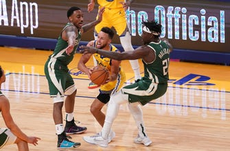 Curry outshines Bucks' Middleton, Holiday in 122-121 loss