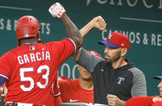 Adolis Garcia homers in 10th to give Rangers walk-off win over Astros, 7-5