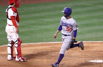 Dodgers' 13-0 lead nearly evaporates, but they hold on to beat rival Angels, 14-11