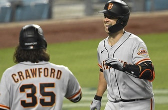 Giants score three in tenth after wild ninth inning by Dodgers, win 8-5