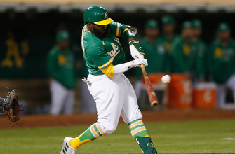 Josh Harrison drives in two runs to help A's top Giants, 4-1 thumbnail