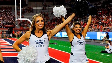 Sep 13, 2014; Tucson, AZ, USA; Nevada Wolf Pack cheerleaders cheer on their team during the second quarter against the Arizona Wildcats at Arizona Stadium. Arizona won 35-28. Mandatory Credit: Casey Sapio-USA Nevada cheerleaders