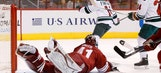 Coyotes overtaken late by red-hot Wild