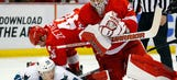 Howard benched as Wings fall to Sharks, 6-4