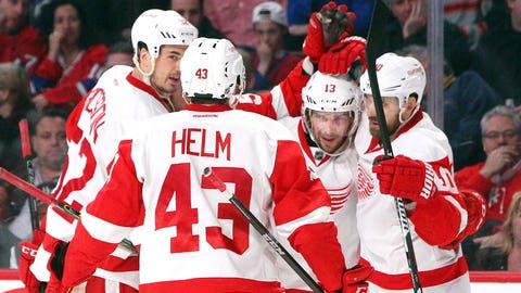 Wings clinch 24th straight playoff berth with bittersweet point at Montreal