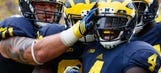 Michigan's Smith stars against BYU but leaves early with injury