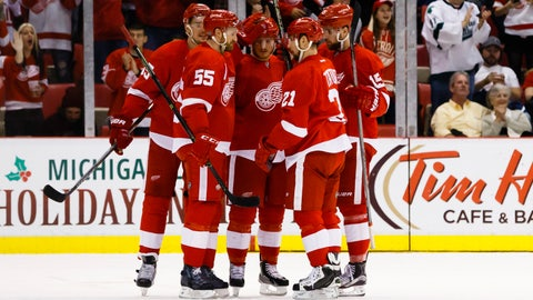 Red Wings hold on to third-period lead, top Flames 4-2