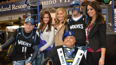 """The TWolves Army and the FOX Sports North Girls cheering on the team to a """"W""""."""