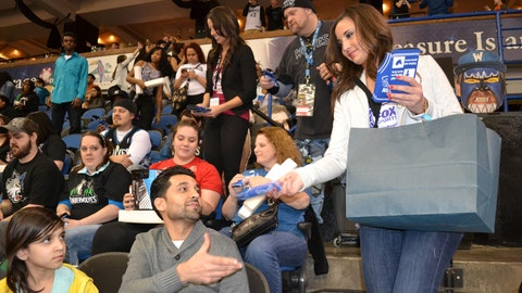 Angie hands out FOX Sports North Girls basketball jersey bottle coolies to fans.