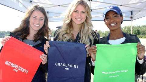 The FOX Sports Wisconsin Girls helped Brewers fans prepare for the new FOX TV shows with branded backpacks.