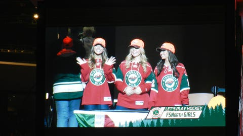 The FOX Sports North Girls take over the big screen and get fans excited for the game.