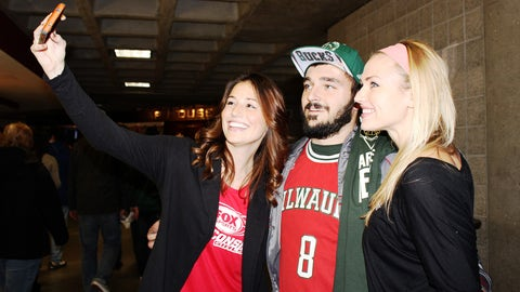 Chyna & Sage take a selfie with a Bucks fan.