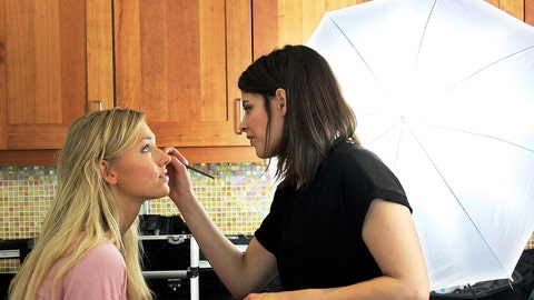 All in a day's work! Chyna gets her makeup done for the shoot.