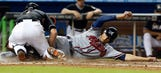 Marlins rally in 8th but fall to Braves in extra innings