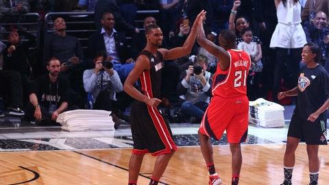 Bosh and Wilkins celebrate