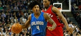 Magic rally to force OT, but fall to Raptors in London