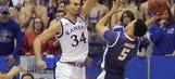 Ellis helps No. 8 Kansas hold off feisty TCU