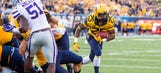 West Virginia slips past K-State with 14-point fourth quarter