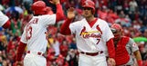 Cardinals take down Reds 5-3 in home opener