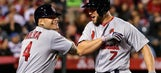 Cards make it tense before completing sweep of Angels