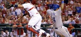 Cards rally late — twice — but fall 3-2 to Royals in extra innings