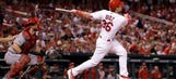 Cards power past emotions, bounce back against Reds